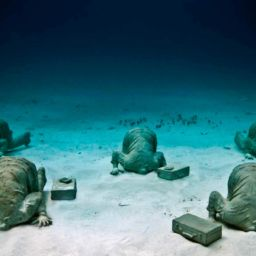 The Bankers sculpture by Jason deCaires Taylor Cancun Underwater Museum